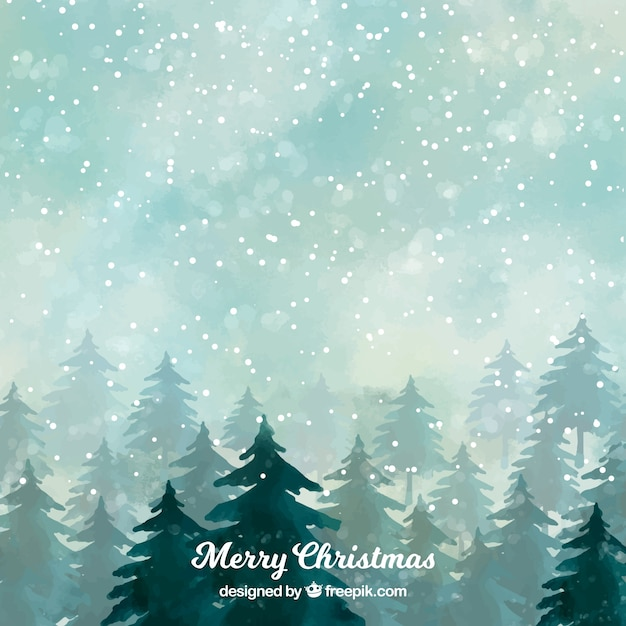 Snowy forest on a christmas night Free Vector