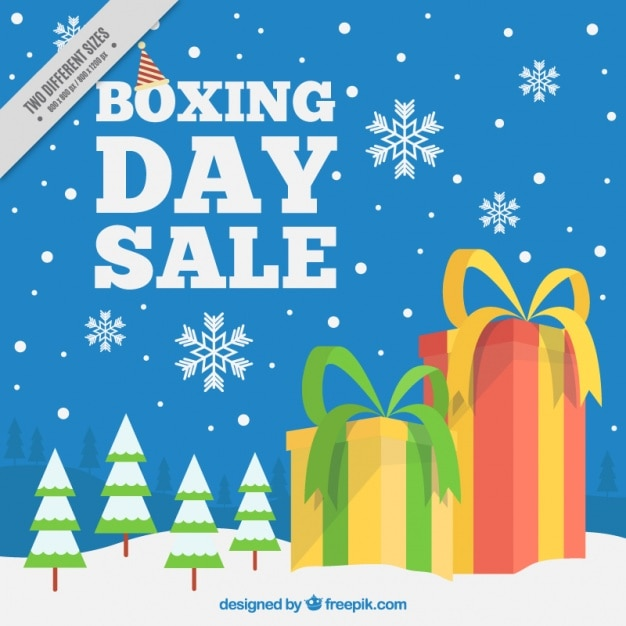 Snowy landscape background with boxing day\ gifts
