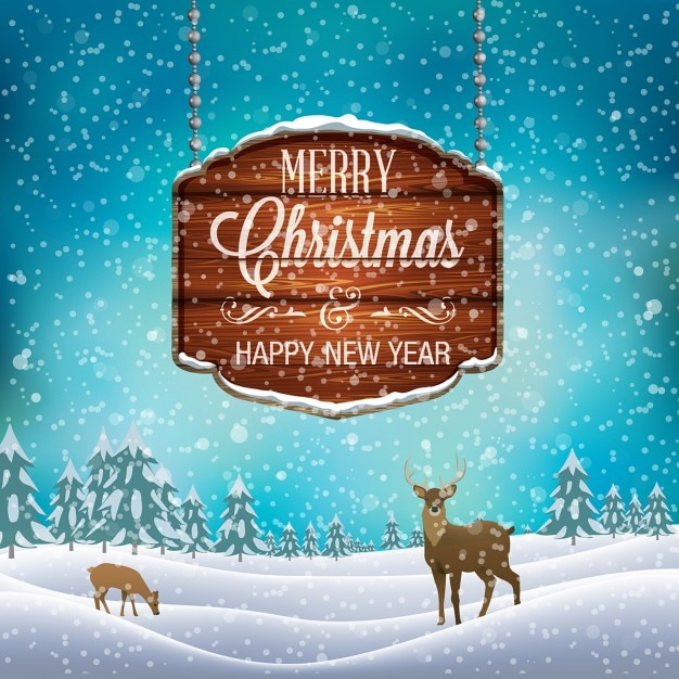 Snowy landscape with deer and christmas wood sign Free Vector