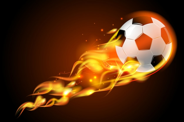 Soccer ball fire on black background Free Vector