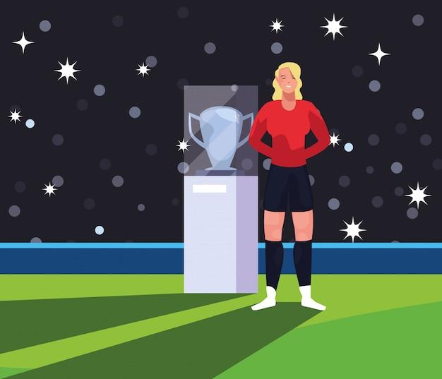 Женщина футболиста на стадионе с трофеем Premium векторы