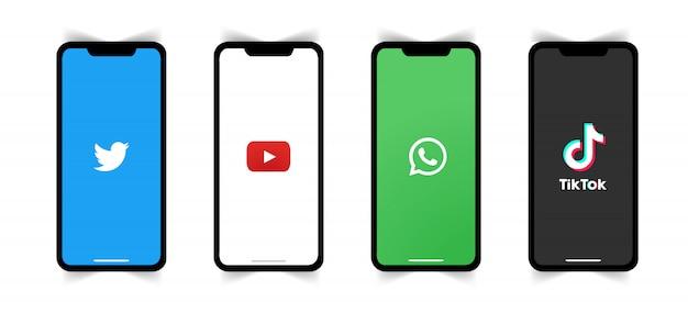 Логотип социальных сетей на экране телефона. Premium векторы