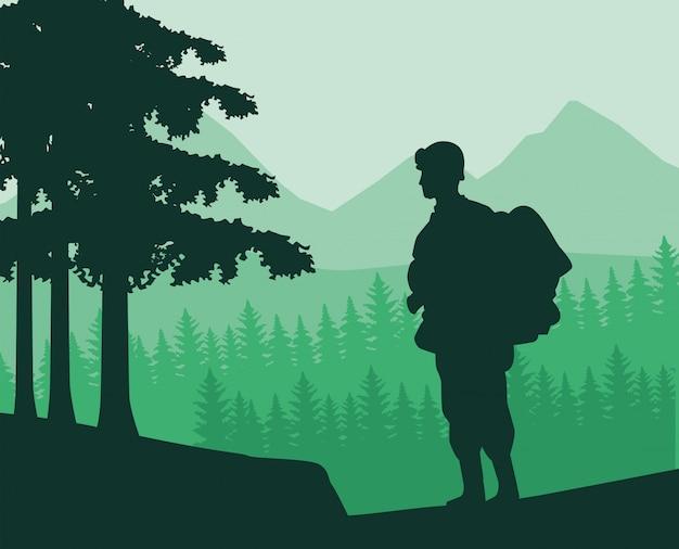 ジャングルの中でライフルの図のシルエットを持つ兵士 Premiumベクター