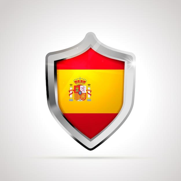 Флаг испании спроектирован как глянцевый щит Premium векторы