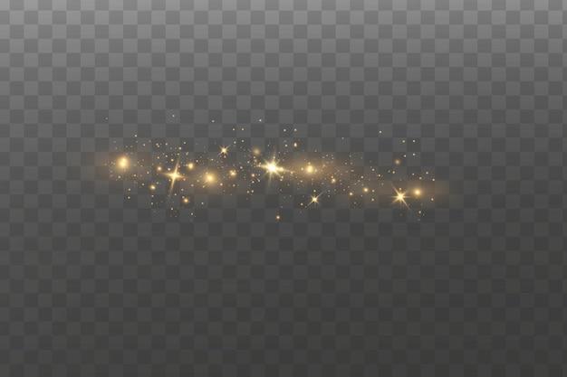 きらめく魔法のほこりの粒子。ほこりの火花と金色の星が特別な光で輝いています。 Premiumベクター