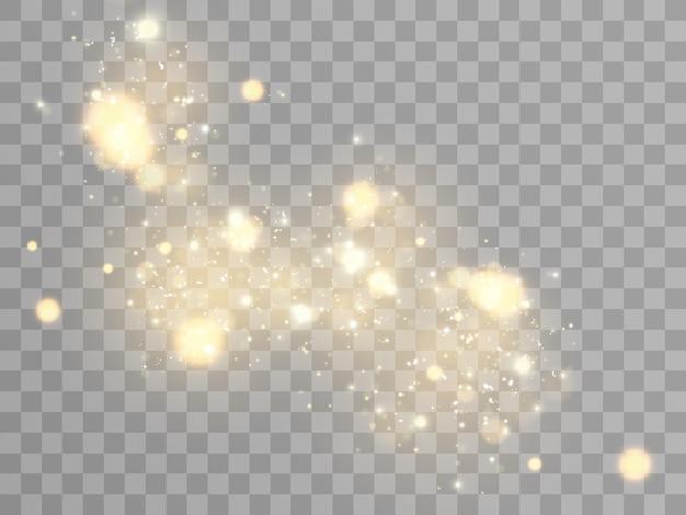 火花と金色の星が特別な光の効果を輝かせます。透明な背景にきらめきます。クリスマスの抽象的なパターン。きらめく魔法のほこりの粒子。 Premiumベクター