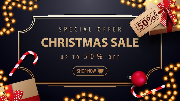 Special offer christmas sale up to 50% off dark blue discount banner with garland Premium Vector