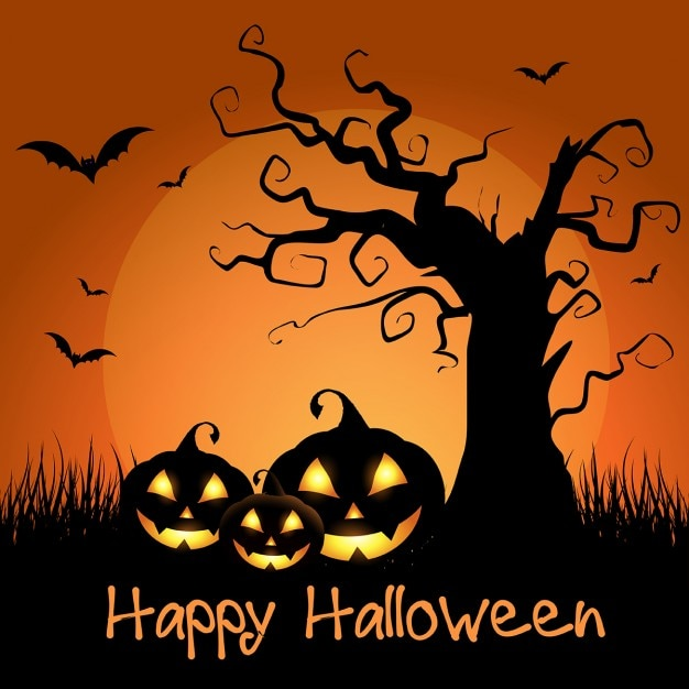 Spooky halloween background with tree and pumpkins Free Vector