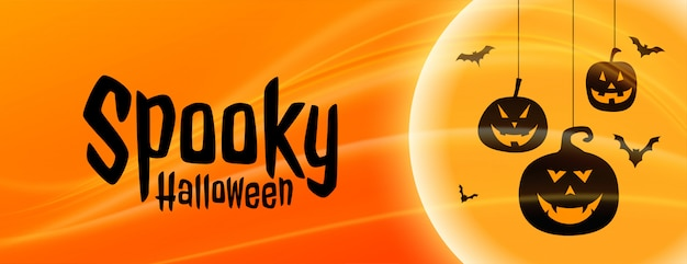 Spooky halloween banner with hanging pumpkin shapes Free Vector