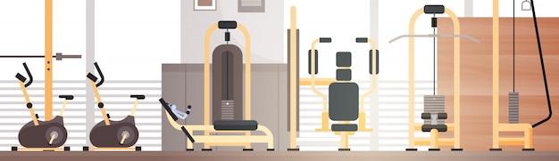 Sport gym interior workout equipment copy space Premium Vector