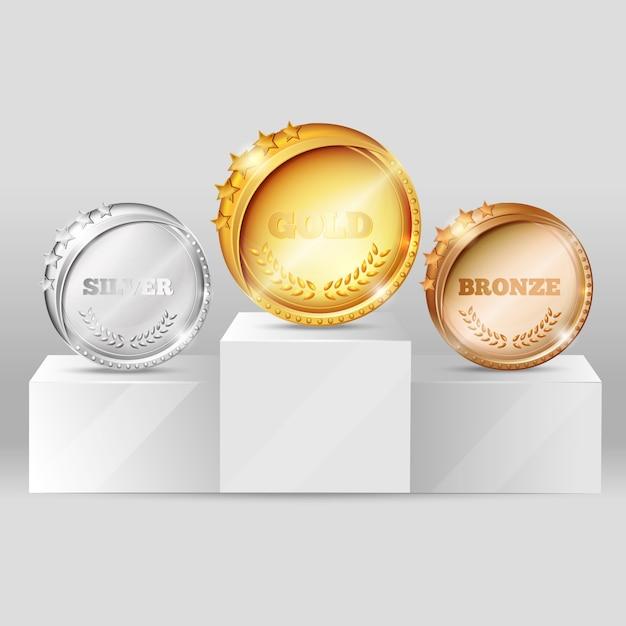 Спортивные медали на постаменте design Бесплатные векторы