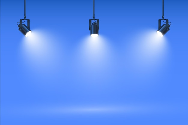 Spot lights on studio blue wall background Free Vector