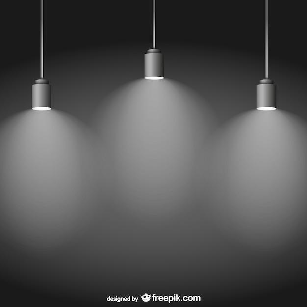 Spotlights on black background Free Vector