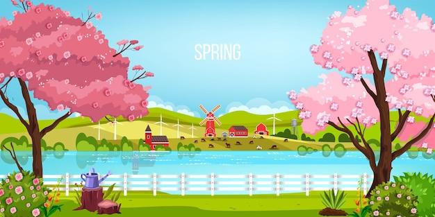 川、咲く桜の木、製粉所、牧草地、丘のある春の風景。 Premiumベクター