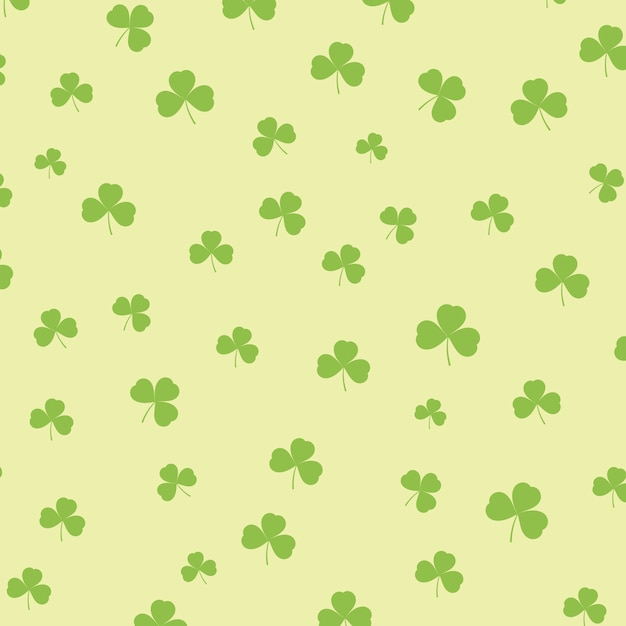 St patricks day background with shamrock pattern Free Vector