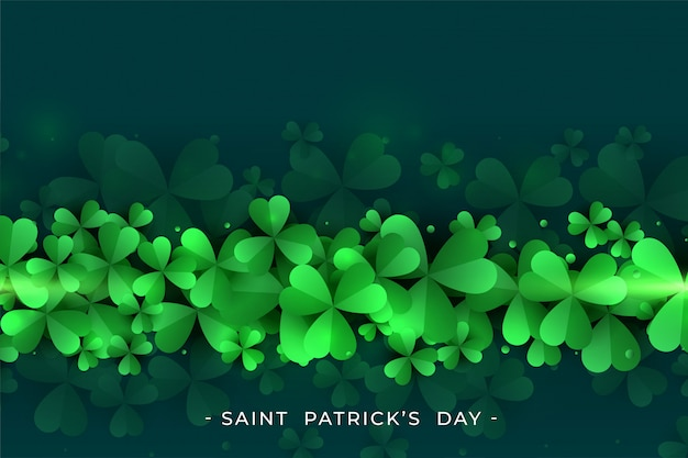 St. patricks day green clover leaves background Free Vector