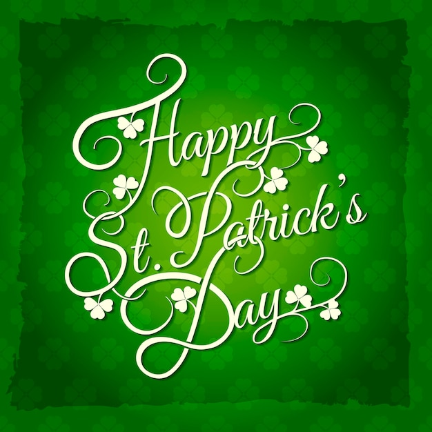 St patricks day hand lettering with shamrocks leaves Free Vector