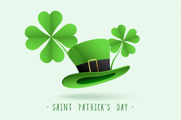 St patricks leprechaun hat and clover leaves background Free Vector