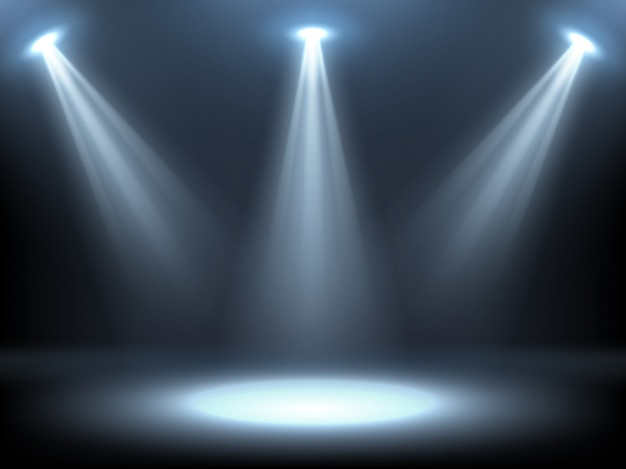 Stage illuminated by spotlights Free Vector