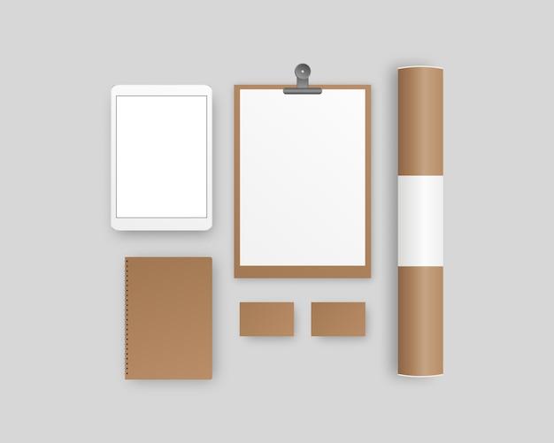 Канцелярские товары с буфером обмена, бумага, блокнот, планшет, визитки, бумажная труба. фирменный набор канцелярских товаров. шаблон фирменного стиля. Premium векторы