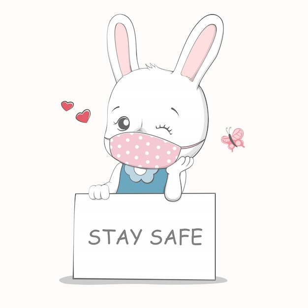 Stay safe message with cute rabbit wearing face mask cartoon hand ...