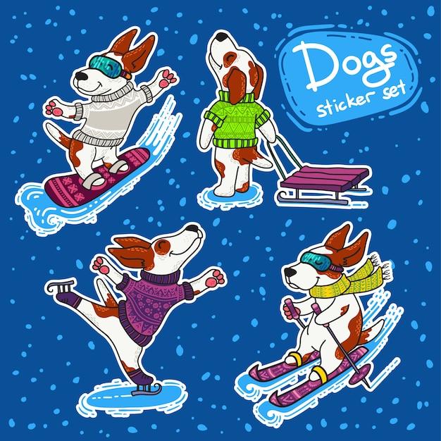 カラフルなセーターの犬との冬のスポーツstikersセット Premiumベクター