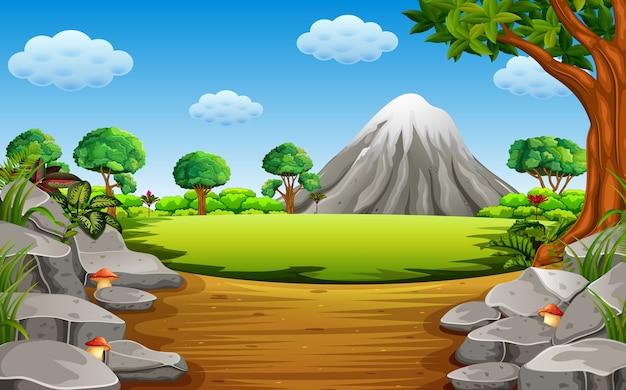 돌 Montain와 키가 큰 나무 프리미엄 벡터