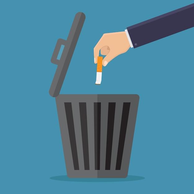 喫煙をやめ、タバコをゴミ箱に捨てる Premiumベクター