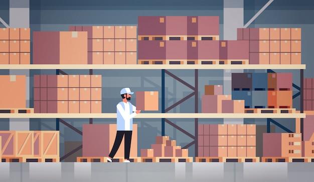 Storekeeper warehouse worker puts cardboard box on shelf Premium Vector