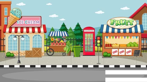 Scena lato strada con gelateria e fruttivendolo Vettore gratuito