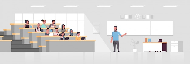 Students sitting at college lecture hall and listening to university male professor over chalkboard education concept modern classroom interior  full length horizontal Premium Vector