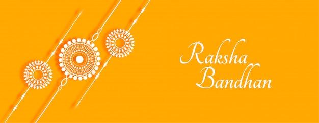 Elegante bandiera raksha bandhan gialla con rakhi Vettore gratuito