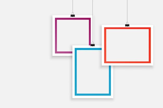 Stylish three blank photo frames background design Free Vector