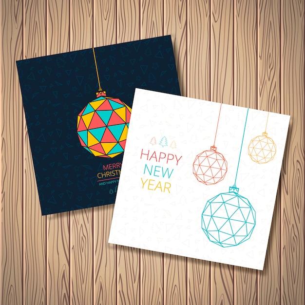 Стилизованные новогодние шары с рисунком из треугольников, деревьев, звезд Premium векторы