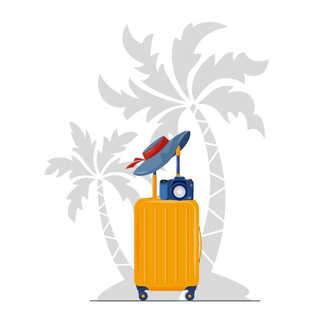 ヤシの木の下に夏用帽子とカメラ付きスーツケース Premiumベクター