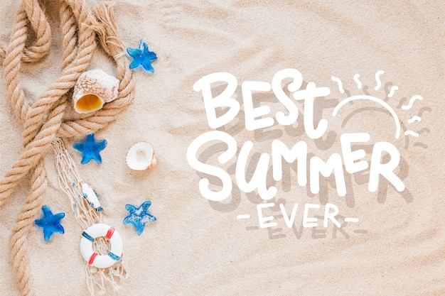 Summer lettering with beach sand and sea shells Free Vector