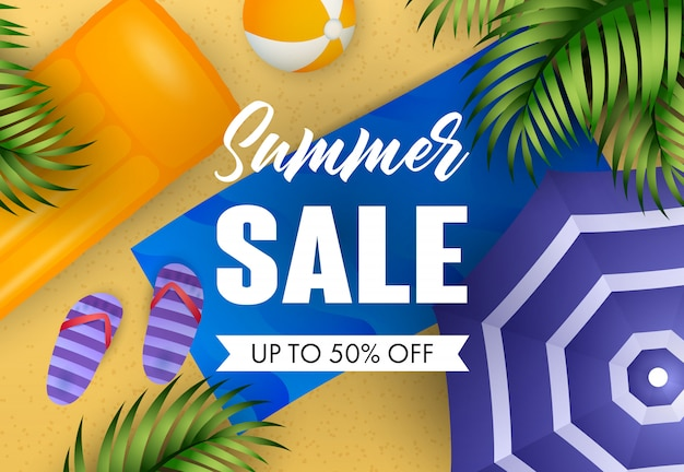 Summer sale lettering with air mattress, beach mat and ball Free Vector