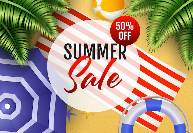Summer sale lettering with beach ball, mat and umbrella Free Vector