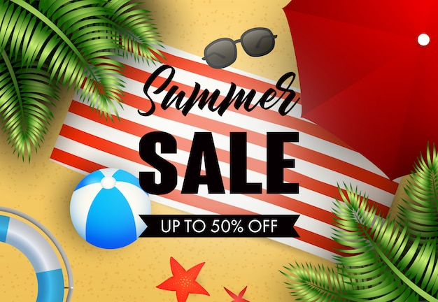 Summer sale lettering with beach mat, ball and umbrella Free Vector