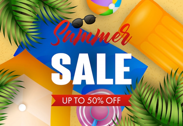 Summer sale lettering with beach mat, hat, ball and air mattress Free Vector