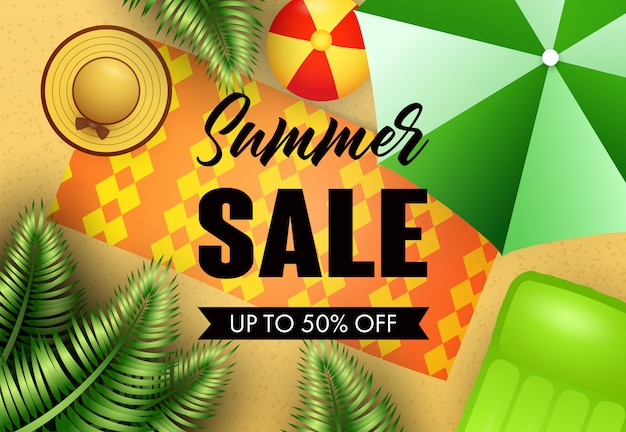 Summer sale lettering with beach mat, hat and umbrella Free Vector