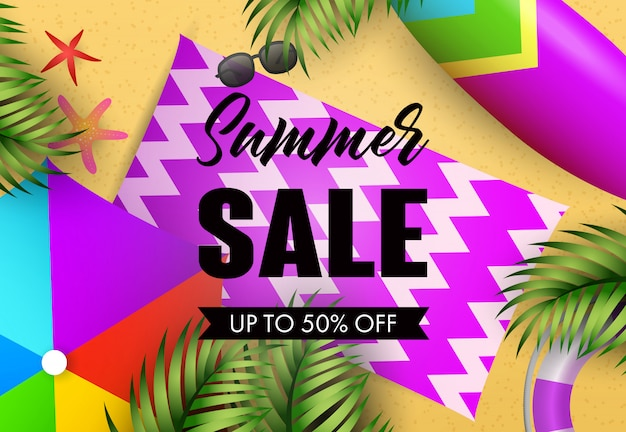 Summer sale lettering with beach mat and tropical leaves Free Vector