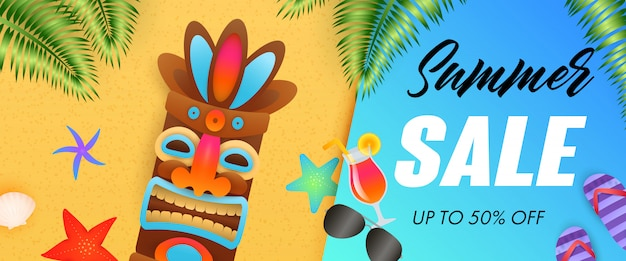 Summer sale lettering with tribal mask and tropical leaves Free Vector