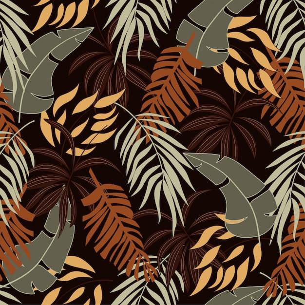Летний бесшовные тропический узор с красивыми оранжевыми и желтыми листьями и растениями Premium векторы