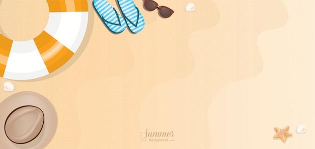 Summer vacation beach accessories on sand - web banner Premium Vector