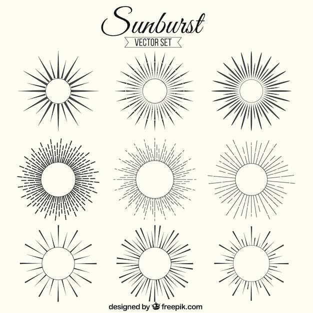 Sunburst ornaments Free Vector