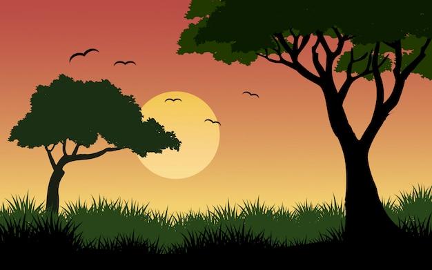 Sunset in savanna with birds Premium Vector