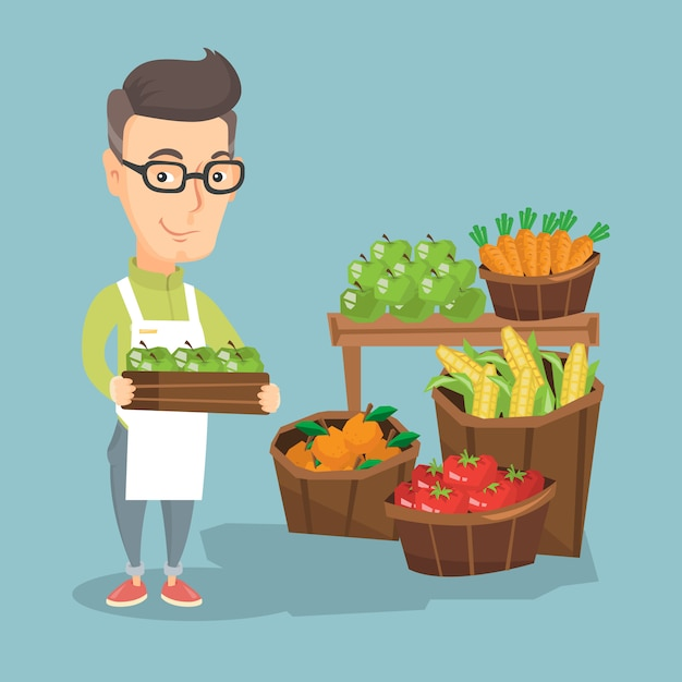Supermarket worker with a box full of apples. Premium Vector