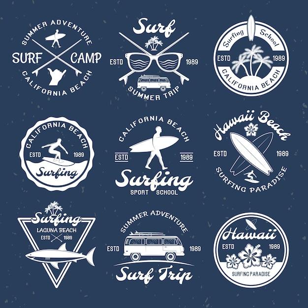Emblemi surf su dark Vettore gratuito