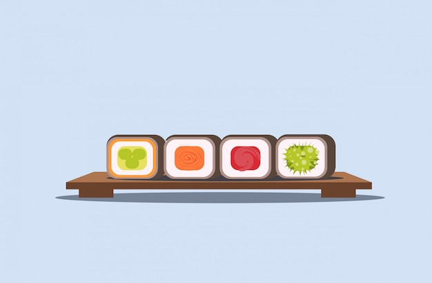 Sushi set rolls on wooden board traditional japanese kitchen concept  horizontal Premium Vector